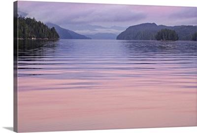Canada, British Columbia, Calvert Island, Sunset reflections on water