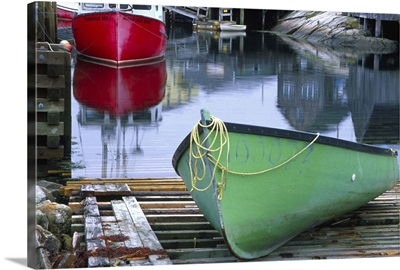 Canada, Nova Scotia, Peggy's Cove. Green dinghy in harbor