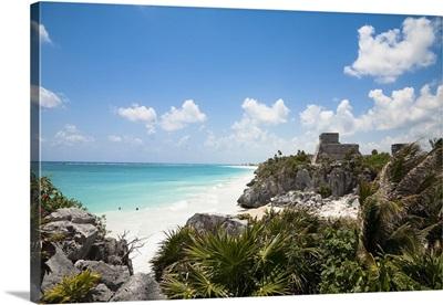 Cancun, Quintana Roo, Mexico, sandy beach behind tropical foliage