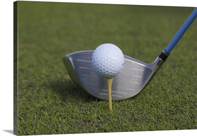 Close-up of a driver and golf ball on  tee
