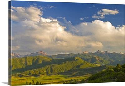 Colorado, Aspen, Old Snowmass Valley. Summer sunset on green mountain vista