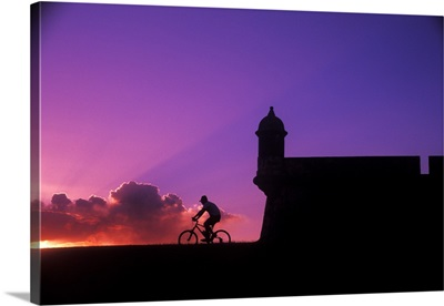 Couple with colorful sunset at El Morro Fort in Old San Juan, Puerto Rico