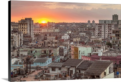 Cuba, Havana. The sun sets over the crowded, decaying city of Havana