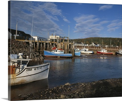 Fishing boats docked at low at in the Bay of Fundy town of Alma, New Brunswick