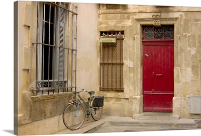 France, Arles, Provence, bicycle parked along building