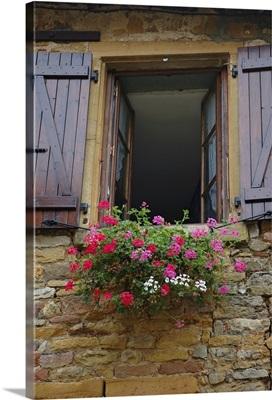 France, Burgundy, Oingt, window of limestone house