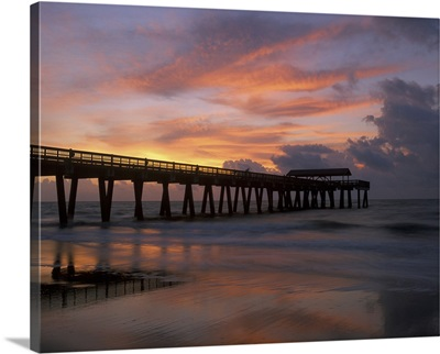 Georgia Tybee Island, pier at sunrise with reflections of clouds on beach