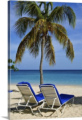 Grenada. Beach chairs on Grand Anse Beach Grenada
