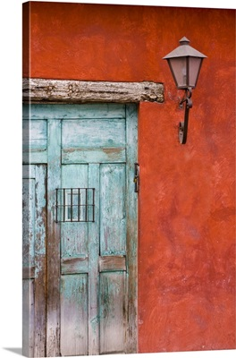 Guatemala, Antigua, aqua blue door against colorful red wall in Antigua