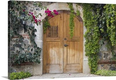 Guatemala, Antigua, entry door at a local coffee plantation in Antigua