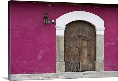 Guatemala, Antigua, ornate wooden doors of home in the town of Antigua