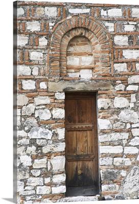 Hagia Triada Church, Detail of old wooden door and arched window, Albania, Balkan