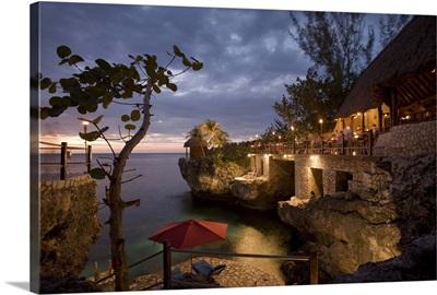 Jamaica, Negril, Rockhouse Hotel at dusk along Caribbean Sea