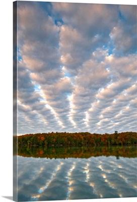 Michigan, Upper Peninsula. Clouds over Pete's Lake in autumn