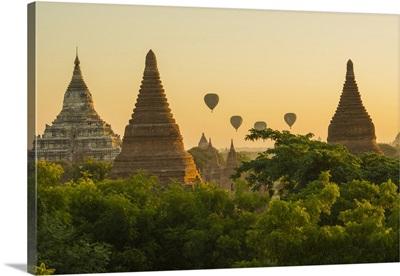 Myanmar. Bagan. Hot air balloons rising over the temples of Bagan