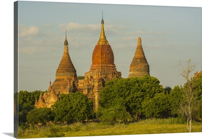Myanmar. Bagan. Red brick temple glows in the late afternoon light