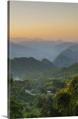 Myanmar. Shan State. Near Kalaw. Sunset over the ridges of haze-filled hills