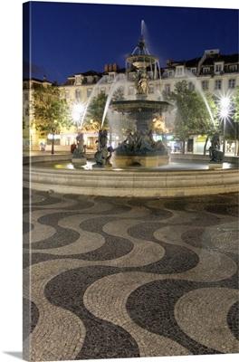 Portugal, Lisbon, Rossio Square at night, Bronze Mermaid Fountain
