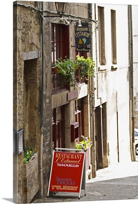 Street scene in Vinenne, a restaurant called lEstancot in the old town, France