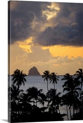 The sun sets behind Diamond Rock, Martinique