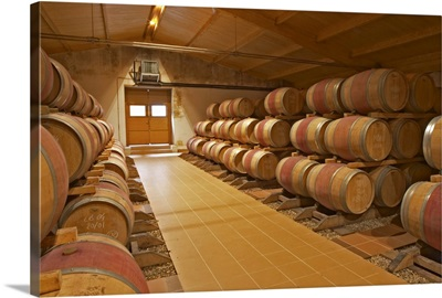 Wine Cellar, Rows And Stacks Of New Oak Barrels With Ageing Wine Chateau Bouscaut