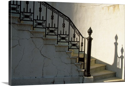 Wrought iron railing and steps with shadow detail