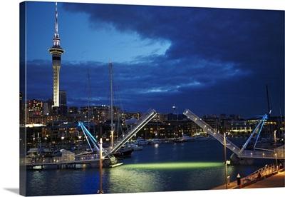 Wynyard Crossing bridge, and Skytower, Auckland waterfront, New Zealand