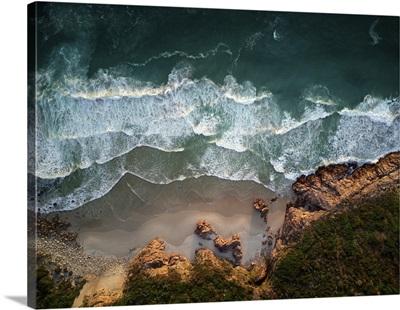 Ocean Waves Breaking On Coastline