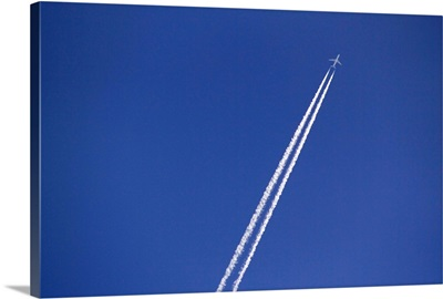 Airplane and vapor trail