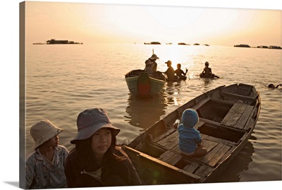 Asia, Cambodia, Children on boat at floating Village of Chong Kneas, Tonle Sap Lake