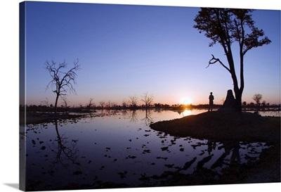 Botswana, Ngamiland, Okavango Delta, Sunset at Dead Tree Island lagoon