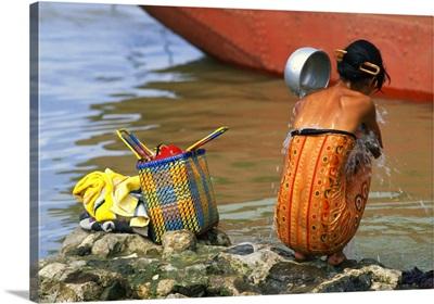 Burma, Mandalay, Woman sitting and washing
