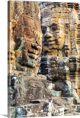 Cambodia, Siemreab, Angkor, Carved Buddha faces in the Bayon Temple