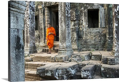 Cambodia, Siemreab, Angkor, Monk walking through the Bayan Temple