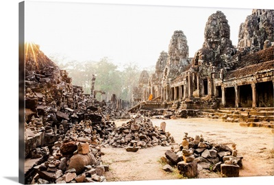 Cambodia, Siemreab, Angkor, Monks leaving the Bayon Temple at sunset