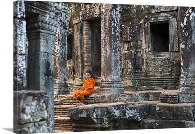 Cambodia, Siemreab, Angkor, Young monk at Bayan Temple