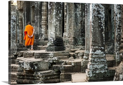 Cambodia, Siemreab, Angkor, Young monk walking through the Bayan Temple