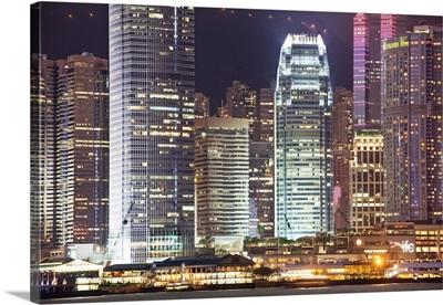 China, Hong Kong, Hong Kong island, City skyline illuminated at night, view from Kowloon