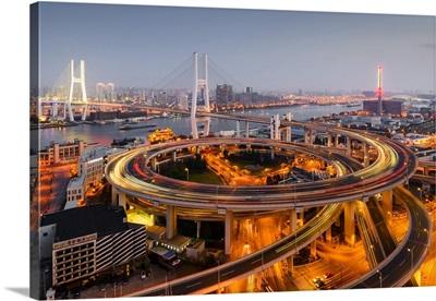 China, Shanghai, Nanpu Bridge over Huangpu River at dusk
