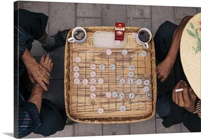China, Yunnan, Dali, Weishan, Men playing Chinese Chess or Xiangqi