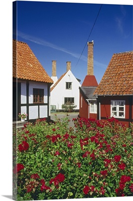 Denmark, Bornholm, Colorfully houses and typical smoking house chimneys