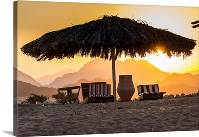 Egypt, Sharm El Sheikh, Nabq Bay, Beach Beds At Sunset With Sinais Mountains Behind