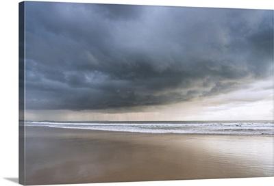 England, Dorset, Bournemouth, Stormy sky over the beach