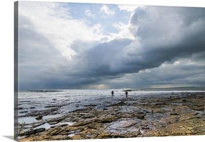 England, Great Britain, Dorset, Surfers at Kimmeridge Bay