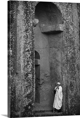 Ethiopia, Amhara, Lalibela, Monk resting outside Biete Gabriel Raphael