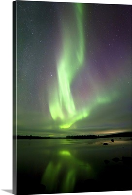 Finland, Lapland, Northern lights reflected in the lake, near Kaaresuvanto