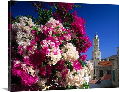 Greece, Dodecanese, Bougainvillea and bell tower of church dedicated to Agios Nikolaos