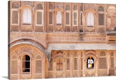 India, Rajasthan, Jodhpur, Man in a window of Mehrangarh Fort
