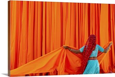 India, Rajasthan, local woman working at a sari factory