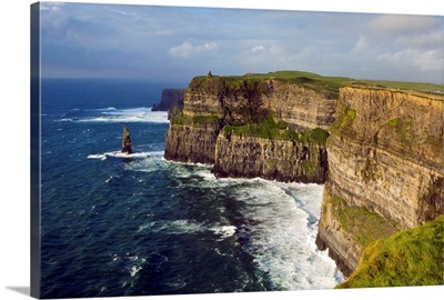 Ireland, Clare, waves generated by Atlantic Ocean storms pound base of Cliffs of Moher